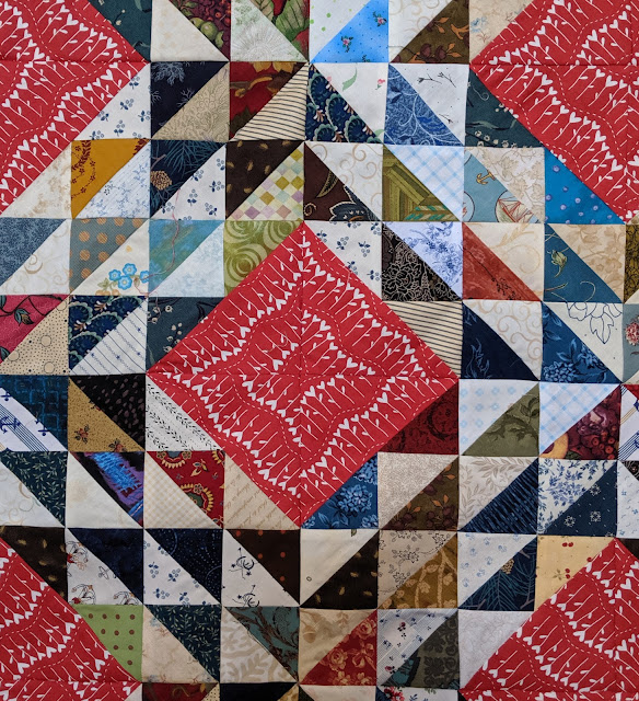 A detail view of four blocks sewn together.