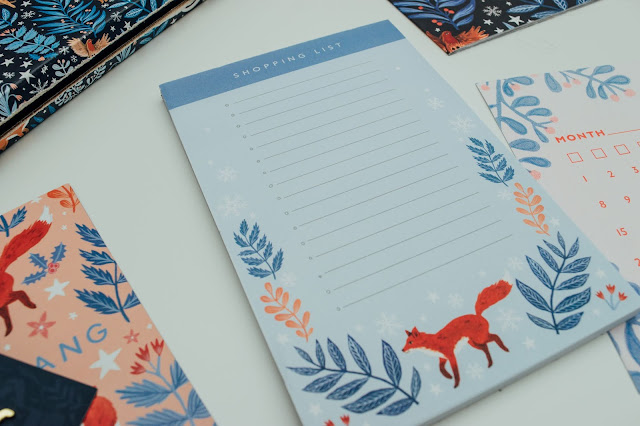 A shopping list pad with a fox illustration on the bottom of the pages