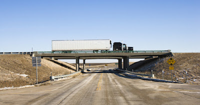 Trucker on bridge renewing his ifta license for 2020