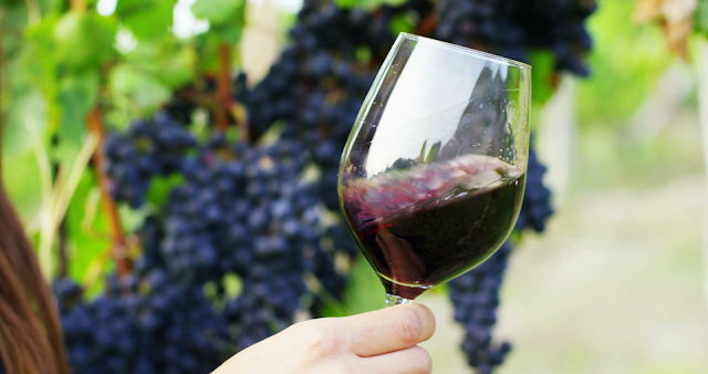 using malic acid to reduce pH in wine