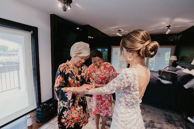 Friends and Family reacting to Bride after getting ready The Manor on St Lucie Crescent Wedding captured by Stuart Wedding Photographer Heather Houghton Photography