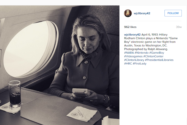 Hillary Clinton plays Nintendo Game Boy on airplane