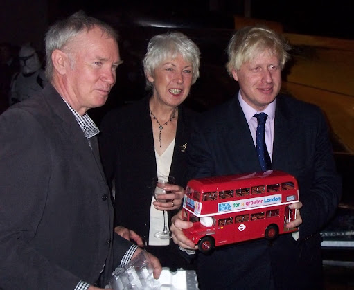 Boris Johnson some other people and a bus