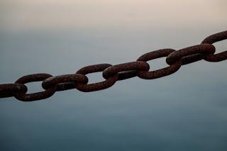 Chains - Photo by Danielle MacInnes on Unsplash