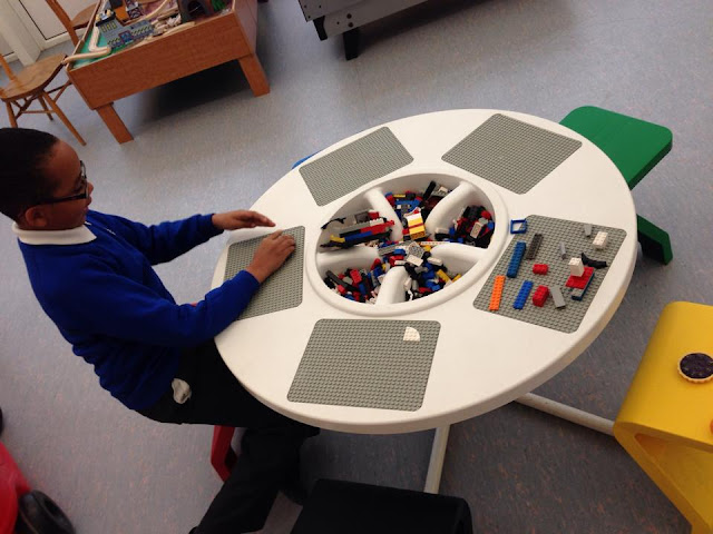 Spud playing with Lego at a table.