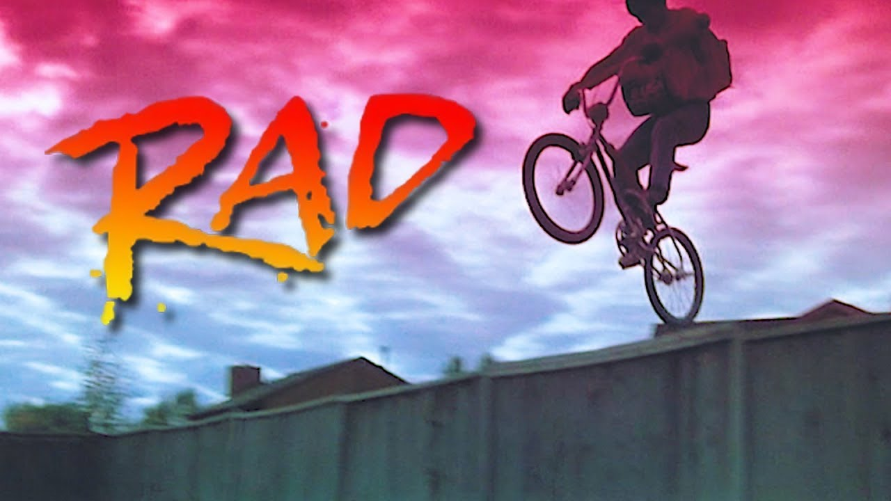 A boy jumping over a fence on a BMX bike from the movie Rad