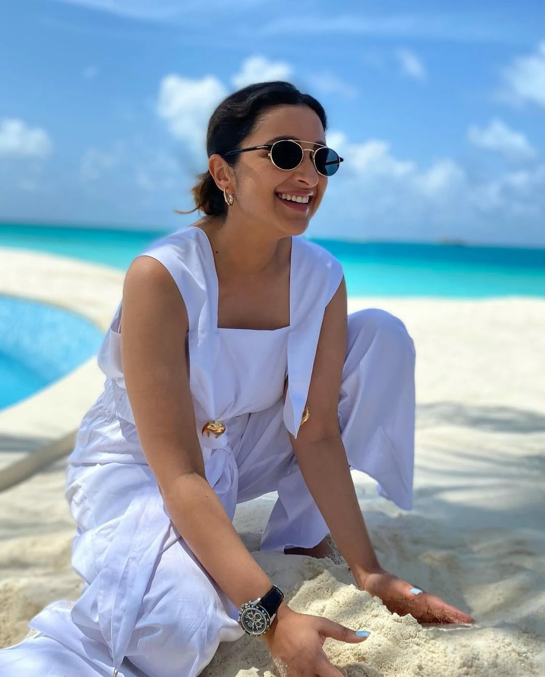 Parineeti Chopra in red swimsuit is too hot to handle - see vacation photos of this Bollywood actress.