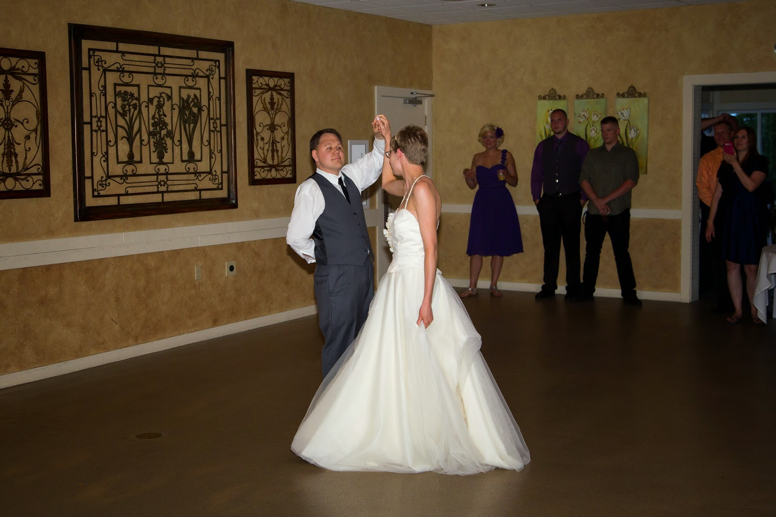 Photo of my wife and I performing our first dance together as husband and wife.