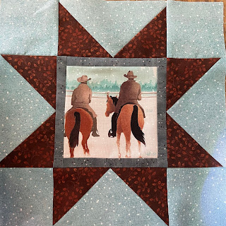Variable Star Quilt Block with a bordered cowboy print in the center
