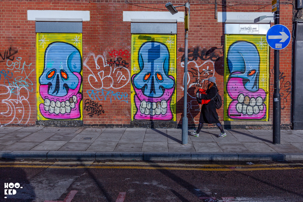 Street Artist Sweet Toof skulla painted on shutters on Sclater Street
