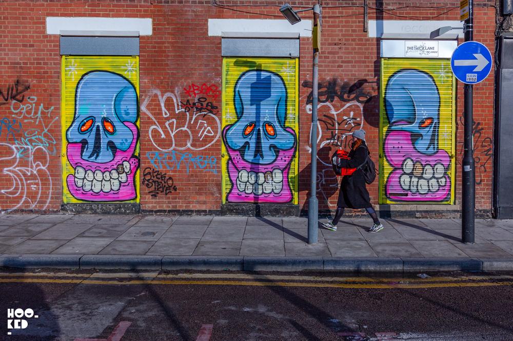 Street Artist Sweet Toof skulla painted on shutters on Sclater Street