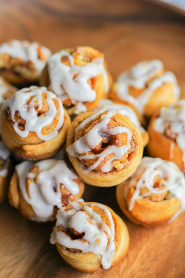 These bite-sized Mini Walnut Cinnamon Buns call for a just a few ingredients and are ready to eat in just 30 minutes! They are perfect for a holiday breakfast or brunch, or just because.