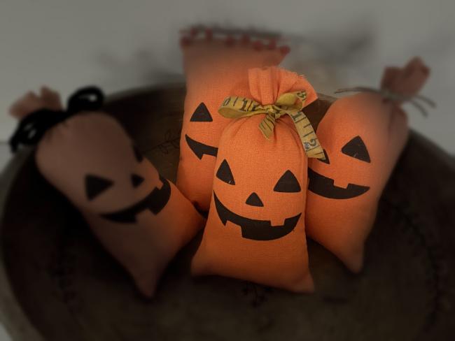 bowl of pumpkin pillows with light
