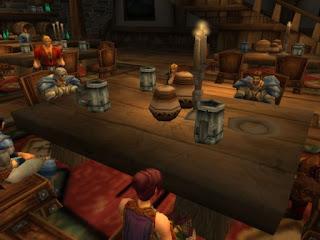 Grupo de personajes de World of Warcraft alrededor de una mesa.