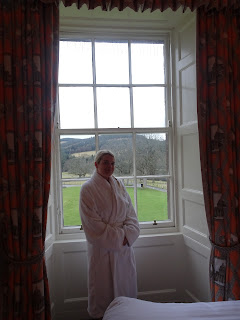 woman posing in white fluffy robe in stobo house
