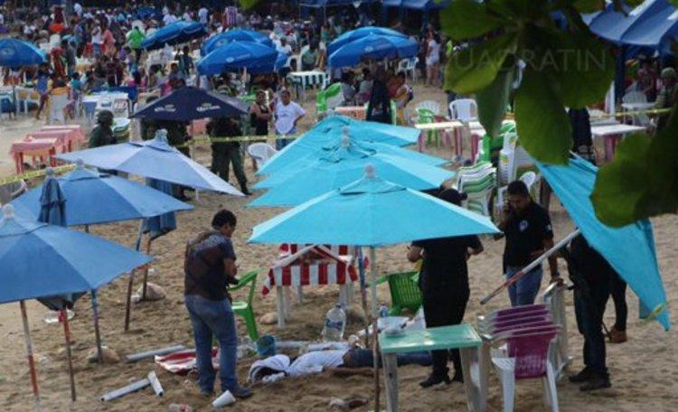 Ataque armado en playa de Acapulco deja dos  ejecutados .
