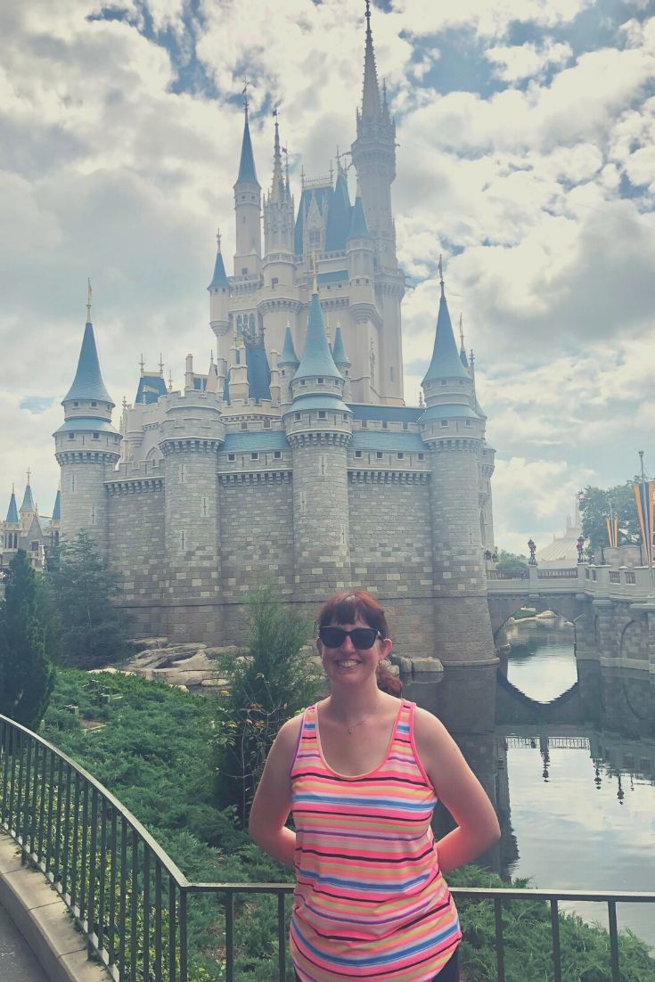 About | N. E. Ellis standing in front of Cinderella's Castle in Walt Disney World.