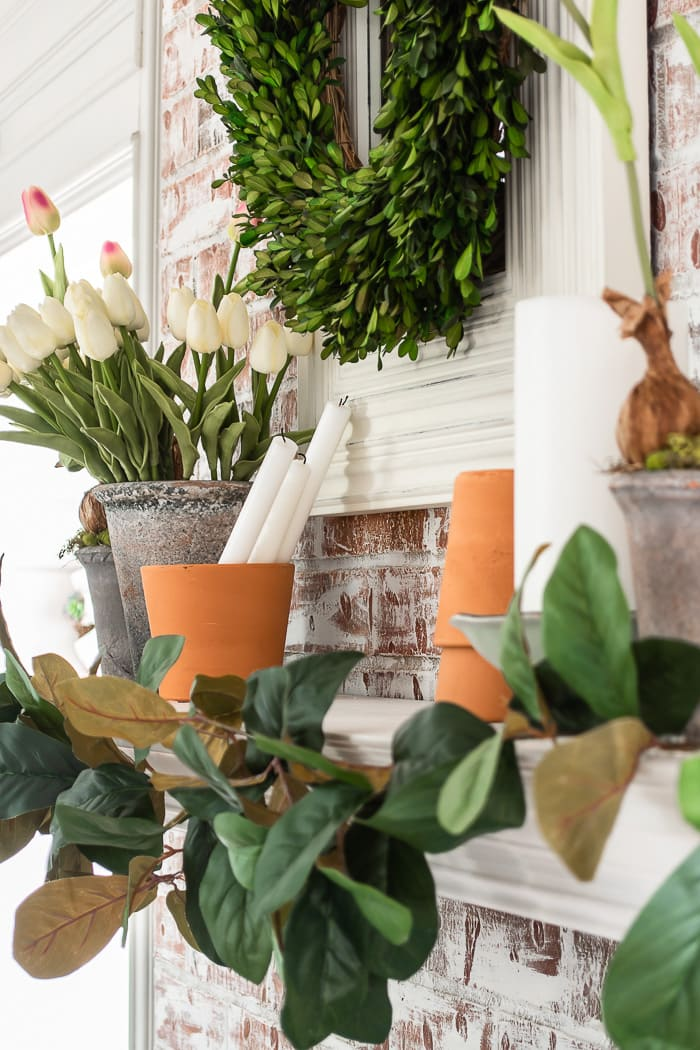 Spring mantel with flower pots
