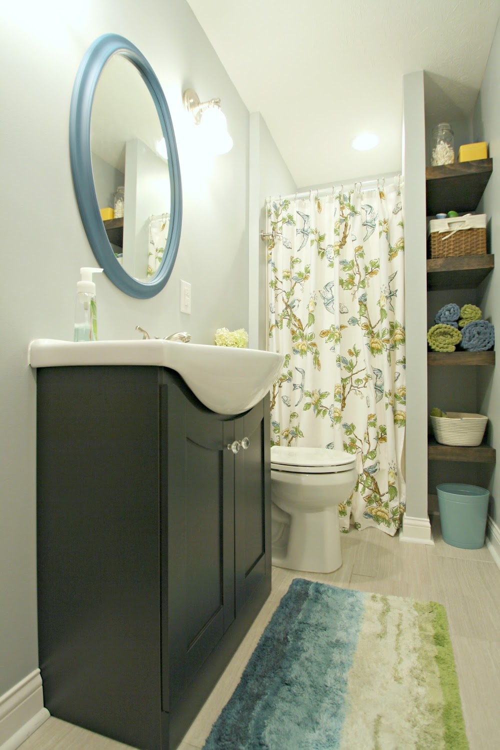 blue and green basement bathroom