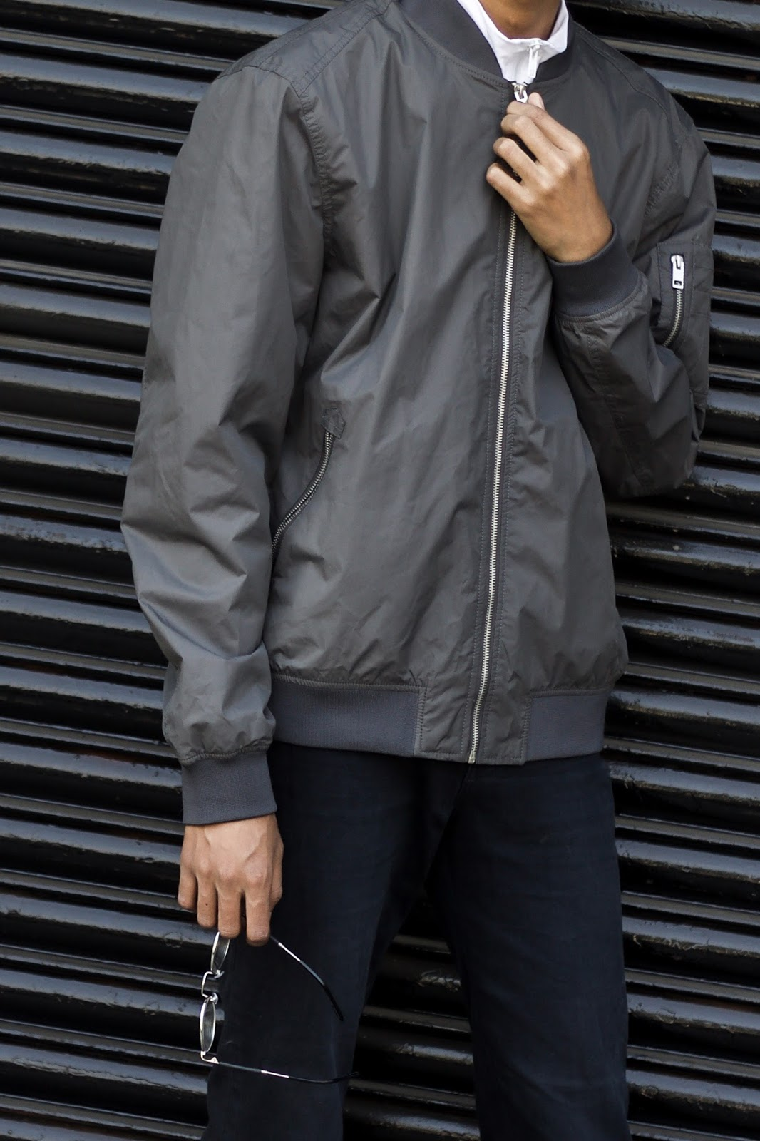 TheQuirkyMinimal by Kangkan Rabha Indian Menswear & Lifestyle blog, Sporty style, menswear, Wering New look bomber jacket, Koovs Funnel Neck Zip T-Shirt, No brand black jeans, Black Vans via jabong & Themojaclub Socks