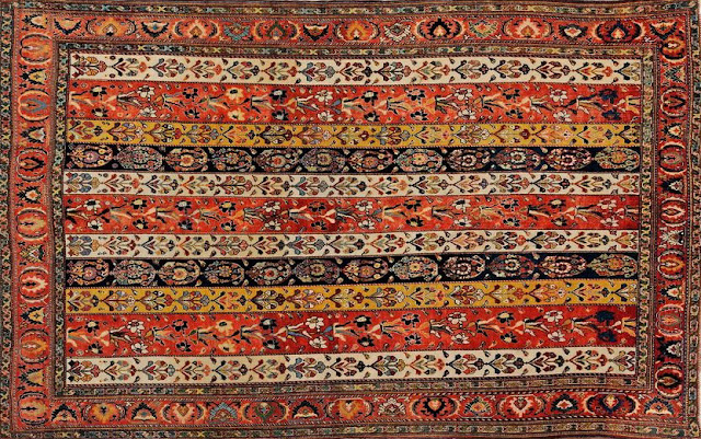 A piece of Qashqai rug with floral motifs.