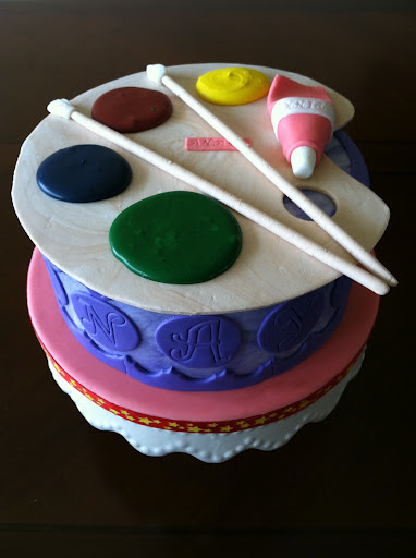 The Cake Was Iced And Adorned With Almond Buttercream Fondant Painters Coloring Board Paint Tube
