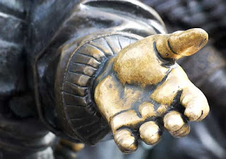 statue's hand reaching out