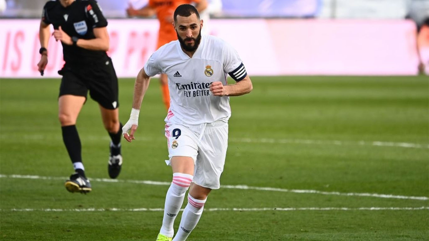 real-madrids-french-forward-karim-benzema-runs-with-the-news-photo