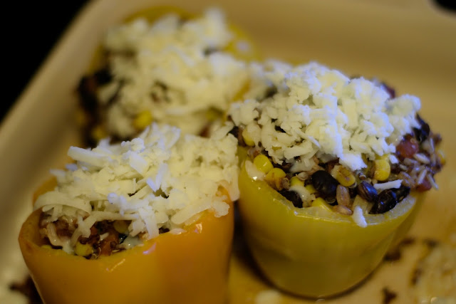 The bell peppers with cheese on top.