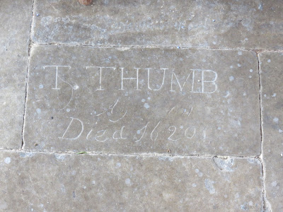 Stone with carved inscription reading 'T.Thumb Aged 101, Died 1620'