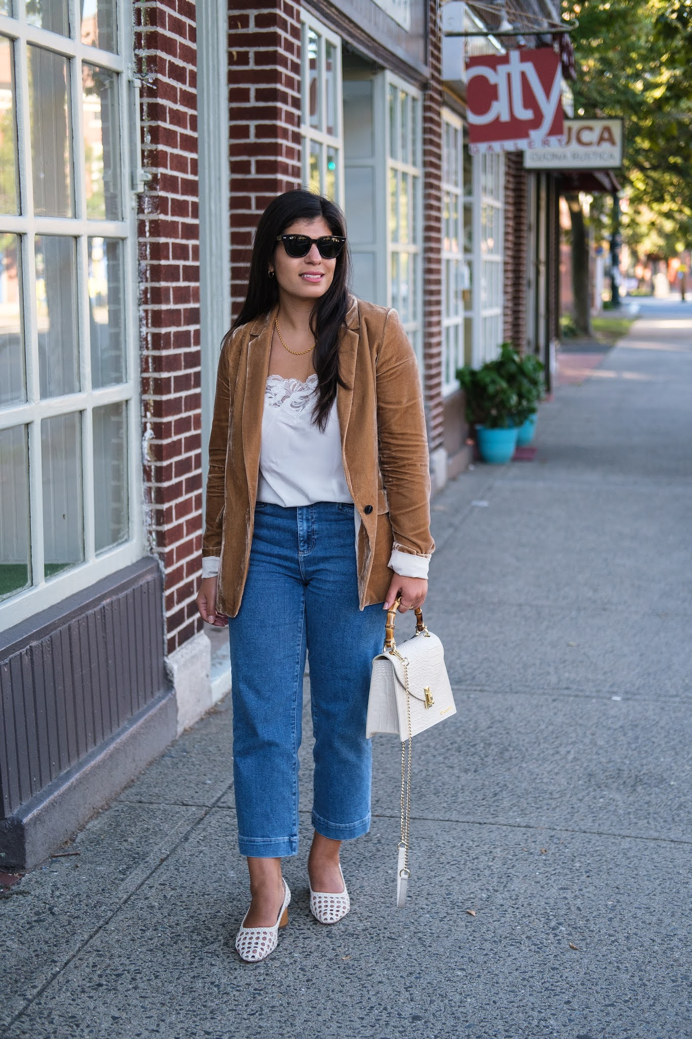 Connecticut style blogger Lydia Abate wearing a camel velvet blazer, straight leg jeans, caned leather pumps, and a croc leather bag for fall