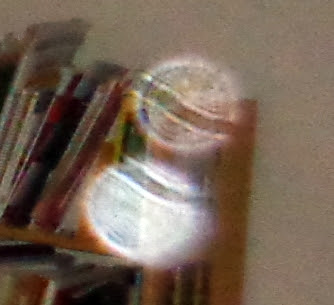 two striped orbs in same photo