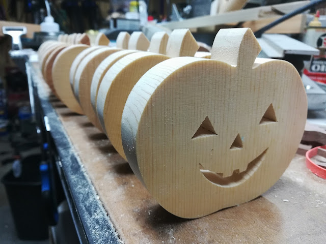 15 Wood Jack-o-Lantern Cutouts in the Shop ready for sanding.