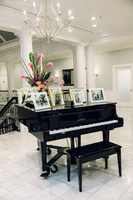 piano with wedding pictures