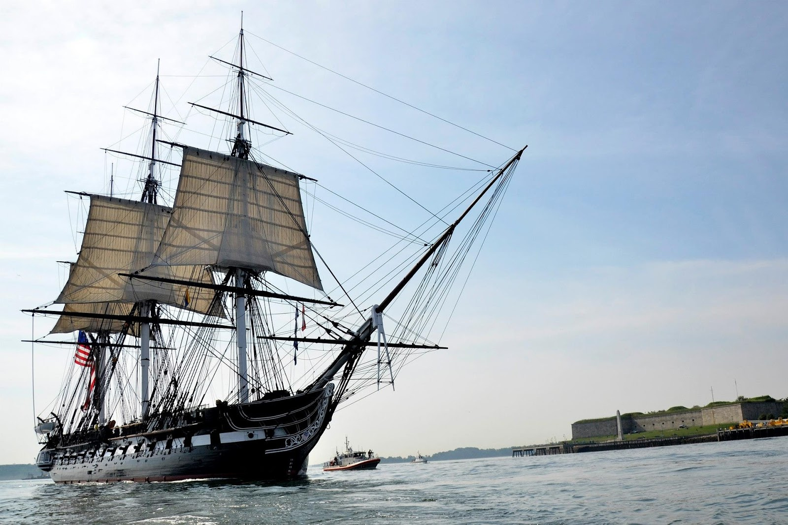 old-fashioned sailing warship sails across calm seas to illustrate a blog post about naval war movies