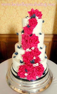 4 tier cerise roses and navy butterflies cake