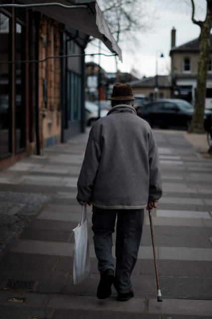 elderly man walking alone Photo by David Sinclair on Unsplash