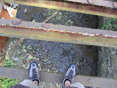 Picture of my feet while crossing the bridge over Kelly's Run
