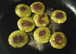 Shallow frying Hara bhara kabab