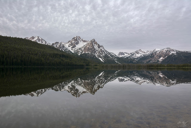 Cloudy reflection of McGown Peak in Stanley Lake Idaho.