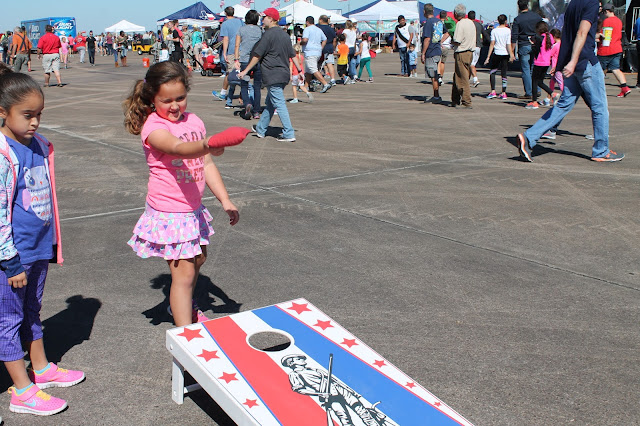 Playing cornhole at the Wings Over Houston Air Show 2016