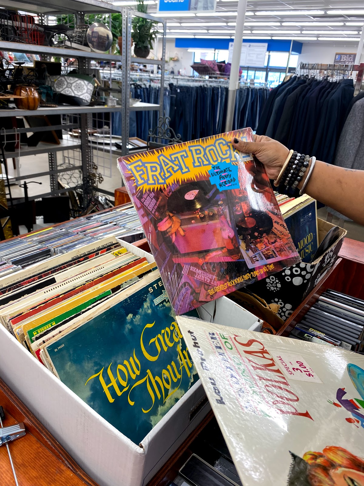 Tangie Bell buying used vinyl records from the thrift store