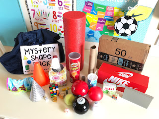 Examples of cubes, cones, spheres, cylinders, and rectangular prisms around the house