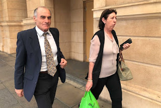 PHOTO: James Salerno (left) leaving court in Adelaide. (ABC News)