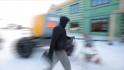 this image is a screen shot from a video edit where speed ramp was used on someone's walking, and motion blur generated around them however the person is relatively sharp while being tracked by camera.