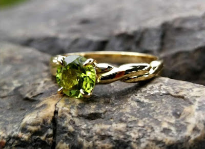 Peridot in engagement ring.