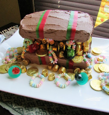 treasure chest cake with chocolate frosting and lots of candy treasure