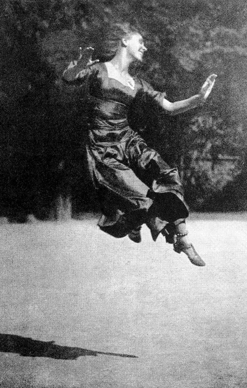 a 1923 dance artist leaping in a photograph