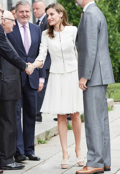 Queen Letizia wore BOSS HUGO BOSS Jeisana Textured Peplum Jacket. Felipe Varela clutch bag and Magrit sandals