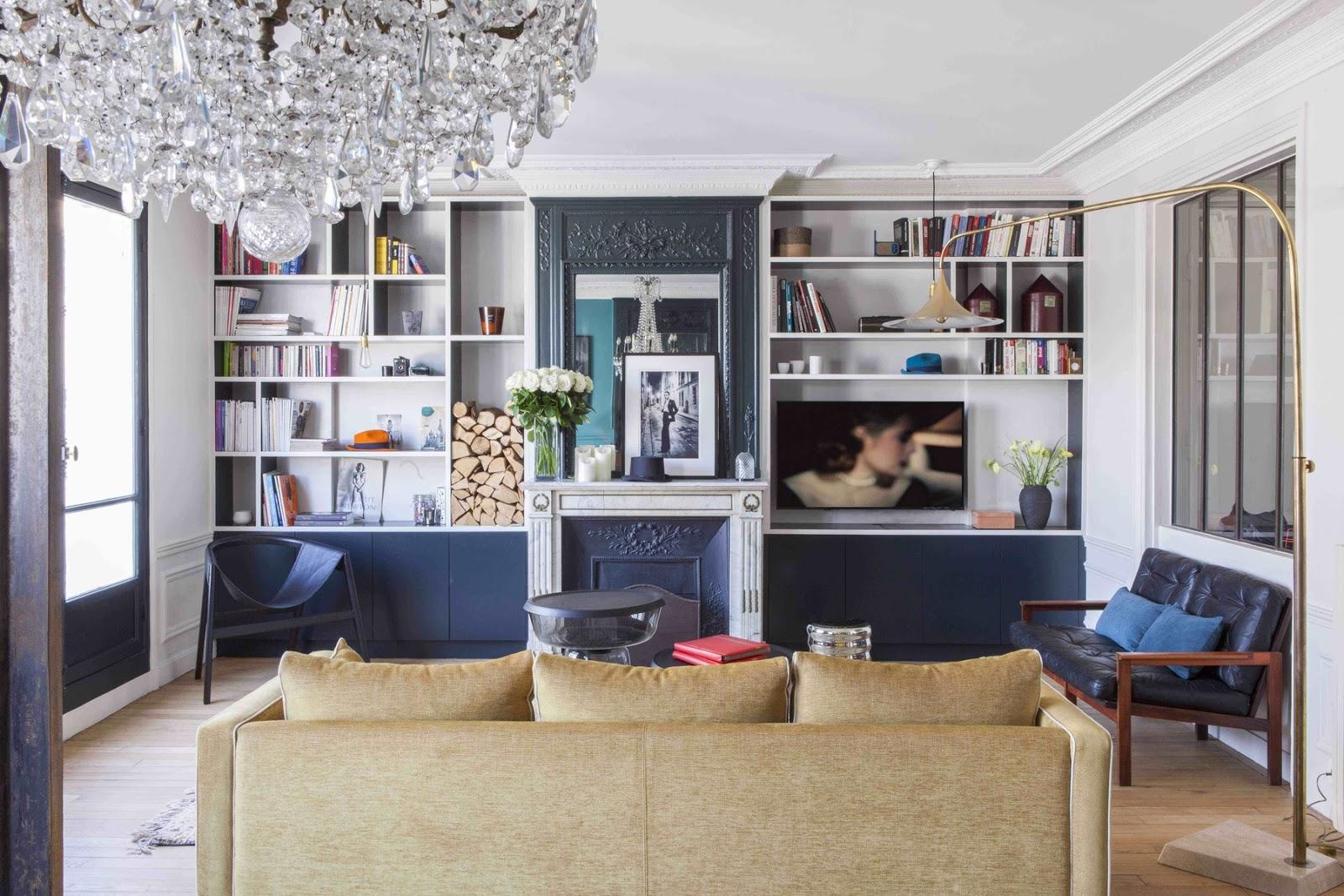 paris apartment with teal color, mid century modern furniture, crystal pendant, bookshelf